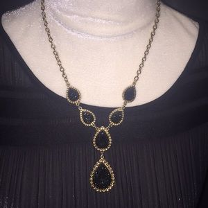 Evening necklace,Gold with black inset on teardrop